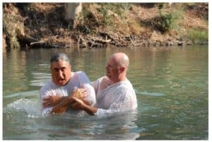 Pastor Todd Wright baptizes Jeff Siegel in the Jordan River.