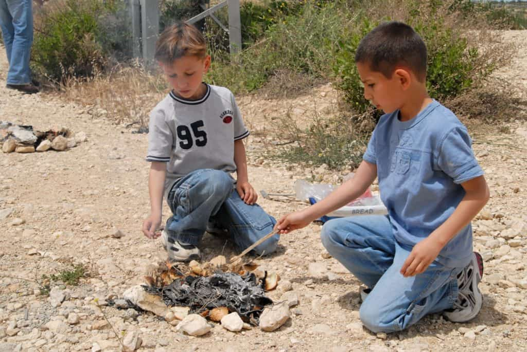 These boys are burning the last leaven found in their homes as part of the Passover tradition.