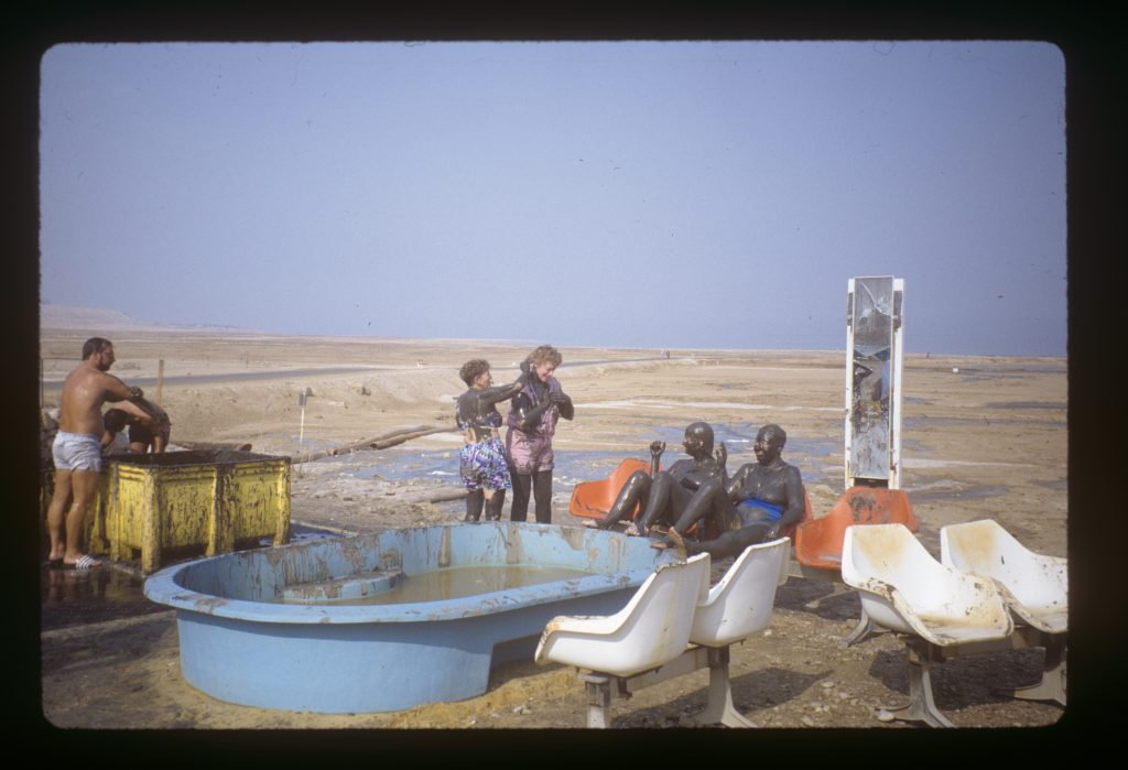 Tourists enjoy Dead Sea mud.