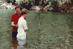Jerry Thorpe baptizes Clark Bosher in the Jordan River, June 1988.