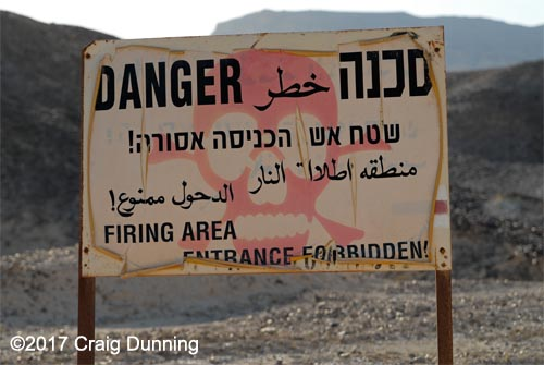 Firing range sign, warning of the dangers of being in the area. Photo: ©2017 Craig Dunning