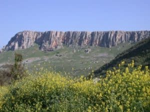 The Arbel Cliff from the valley below.