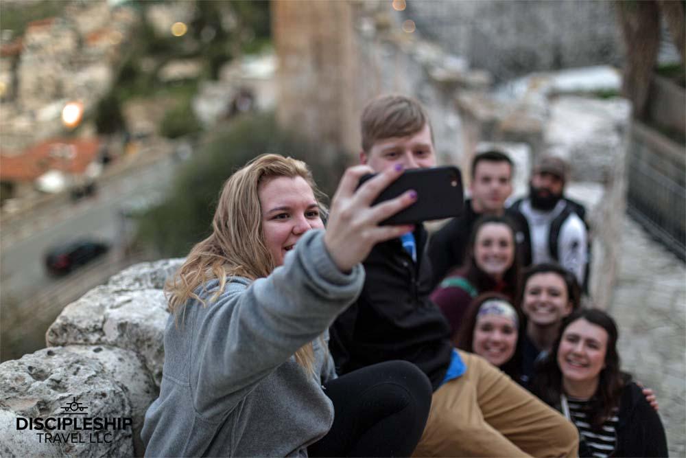 Group taking selfie in Jerusalem photo